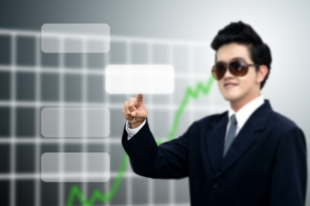 taget: Asian businessman push the blank button with graph background