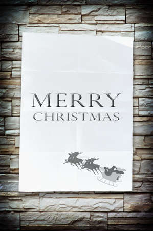 The merry christmas word on the crumpled paper with nice stone wall photo