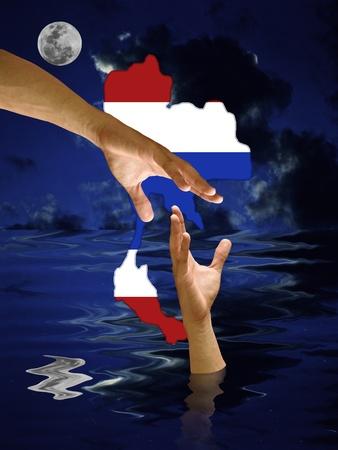 drown: Rescate de la mano ahogar la mano con el s�mbolo de Tailandia y el cielo nocturno Foto de archivo
