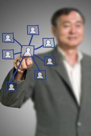 Senior businessman pointed the social network diagram, Social network concept Stock Photo - 11091687