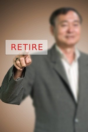 Senior businessman pushed the retire button, Retire concept photo