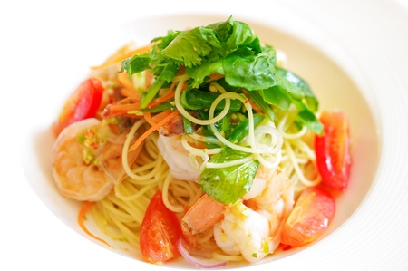 Spaghetti with shrimp on white background photo
