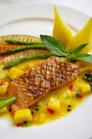Grilled Salmon steak with mango sauce photo