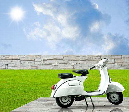 White motorbike on decorate floor in the garden with nice sky Stock Photo - 11374966
