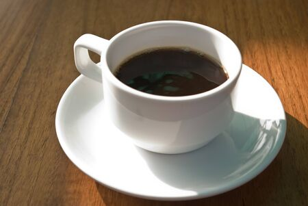 Hot coffee cup in the morning on wooden table photo