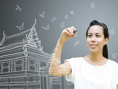 Young artist drawing Thai ancient architecture on the board Stock Photo