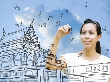 Asian girl drawing Buddhist temple, Travel concept photo