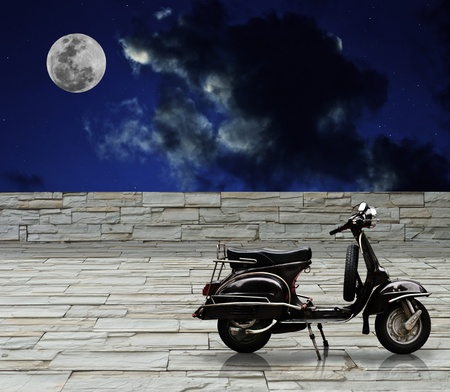 Black retro scooter with full moon photo