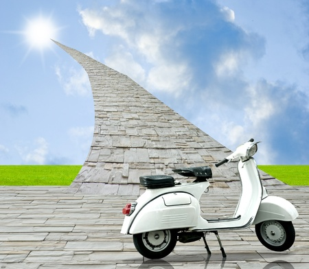White retro scooter with stone road to sun in the sky photo