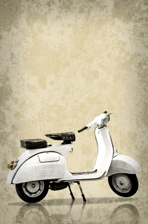 White retro scooter on grunge texture background photo