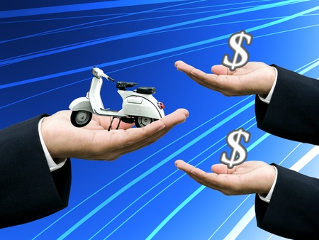 Businessman's hand sell motorbike