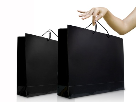 Lady hand pick the black shiny shopping bag, Shopping concept photo