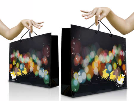 christmas shopping bag: Women hands pick up the christmas shopping bag, Christmas gift concept