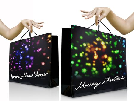 Girl hand pick up the holiday shopping bag with glossy background photo