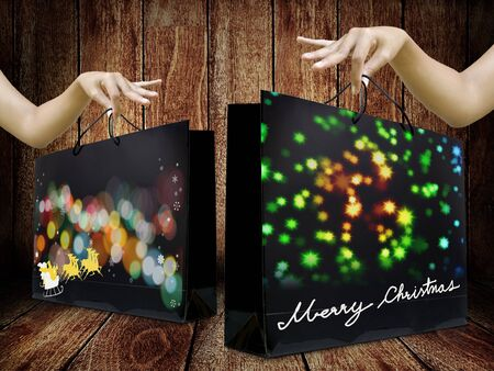 tempt: Lady hand pick up Shopping bag from wooden display, Christmas gift concept
