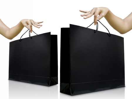 Lady pick up glossy black shopping back on white background Standard-Bild