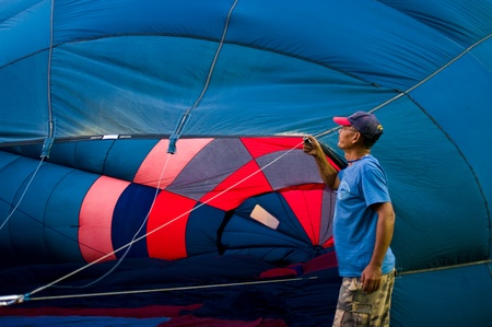 fill fill in: CHIANG MAI - NOV 26: Unidentified man fill hot air in balloon during Thailand balloon festival 2011 at Prince Royal college in Chiang mai, Thailand on Nov 26, 2011.