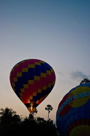 CHIANG MAI, THAILAND - NOV 26 : Balloon floating to sky during Thailand balloon festival 2011 at Prince Royals college in Chiang Mai, Thailand on Nov 26, 2011.