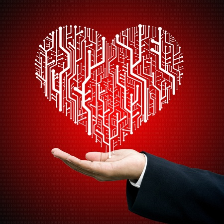 Businessman give the Circuit board in heart shape, Technology background  photo