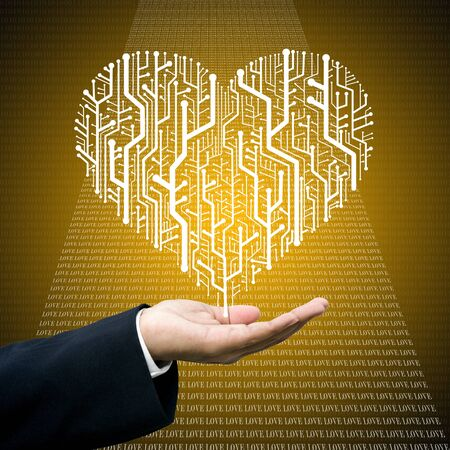 Businessman care the circuit board in heart shape, Technology business concept photo