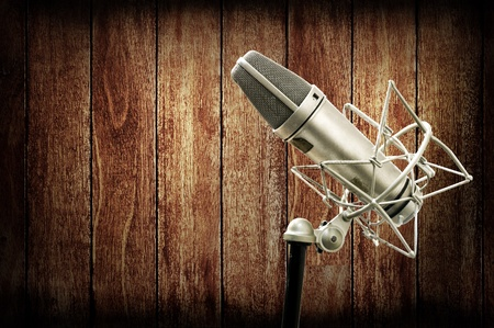 Classic Microphone in studio with wooden wall, Music studio concept photo
