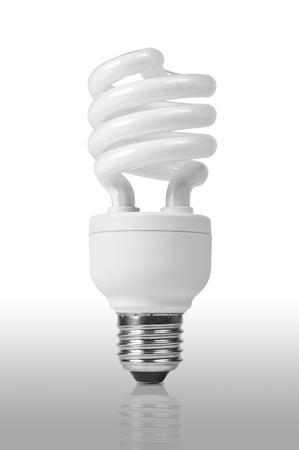 Energy saving fluorescent light bulb on white bakground  photo