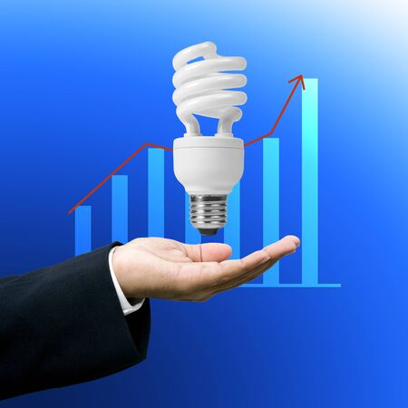 save electricity: Save electricity, Compact flourescent lamp in businessman Stock Photo