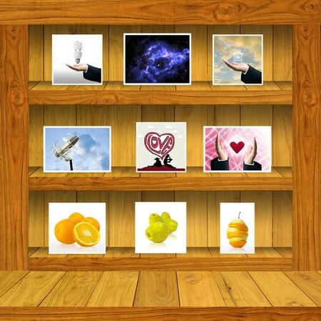 Wood shelf with stock photo inside, Window display concept