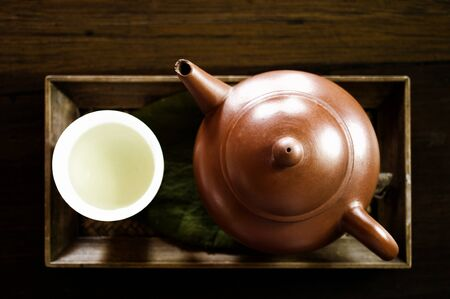 Japanese green tea with wooden tray photo