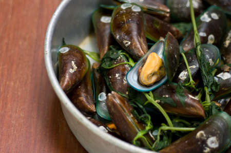 viridis: Boiled Asian green mussel on wooden table Stock Photo