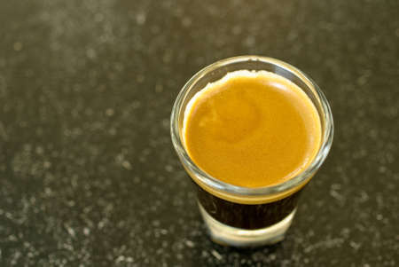 A shot of espresso on classy shot glass Stock Photo