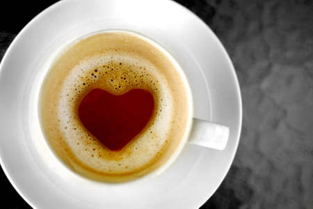 Heart shape inside hot coffee cup photo