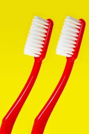 Toothbrush on yellow background Stock Photo - 12803663