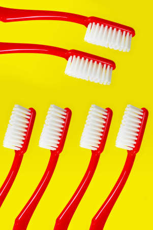 Toothbrush on yellow background Stock Photo - 12803665