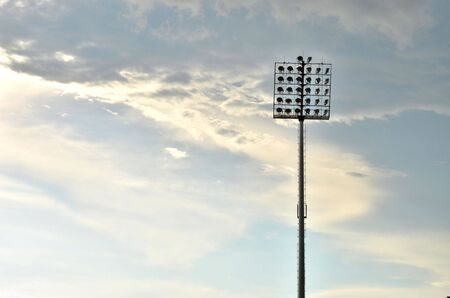 Sport light tower for arena with cloudy sky background photo