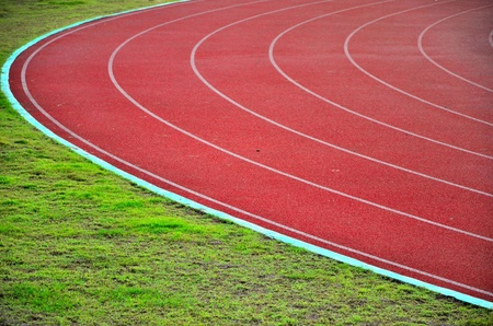 Racetrack in sport arena with grass photo