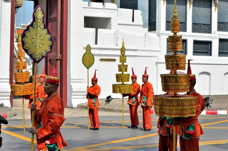 Bangkok, Thailand - April 9 : Soldier in Thai traditional vintage style suit carry the royal fan on April 9, 2012, in The Royal Funeral of HRH Princess Bejaratana Rajasuda of Thailand