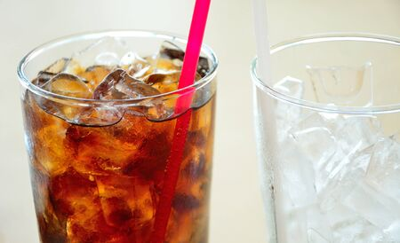 soft drinks: Soft drinks and ice in glass Stock Photo
