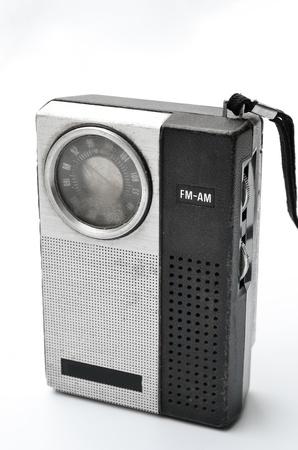 Retro pocket radio on white background photo