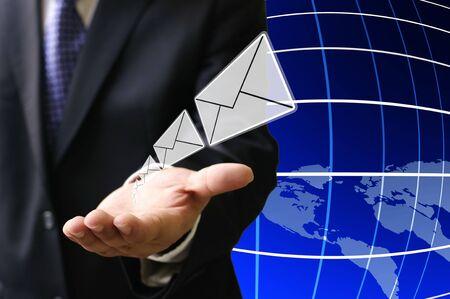 Businessman send email to customer around the world photo