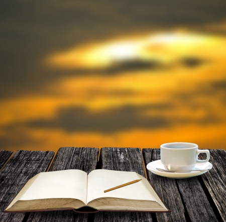 Rest for write on note book and drink hot coffee with sunset views photo