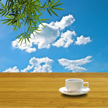 Hot coffee on table with nice blue sky photo