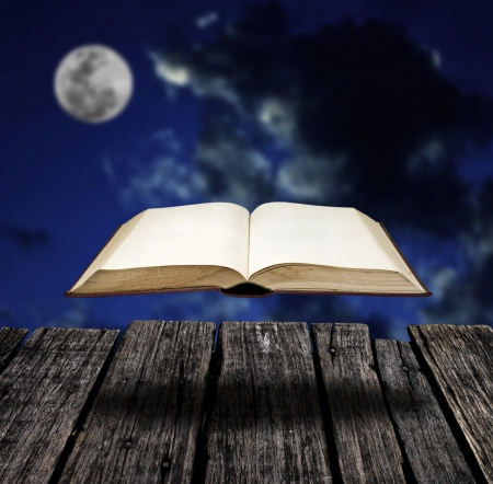 Mystery flying book with night sky photo