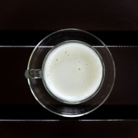 Hot milk cup on table photo