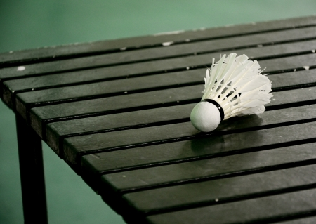 goose club: Shuttle cock on wooden table in the badminton court Stock Photo