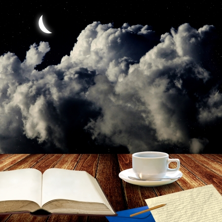 Open book and drink coffee at night for write letter photo