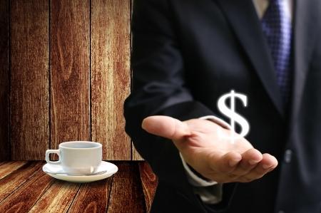 Zakenman geld verdienen van koffie-business Stockfoto