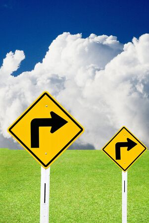 Turn right sign with cloudy sky and nice meadows Stock Photo - 15384366