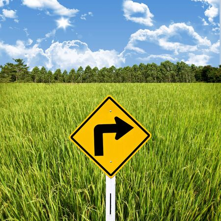 Turn right sign with rice field, Travel in countryside concept Stock Photo - 15407833