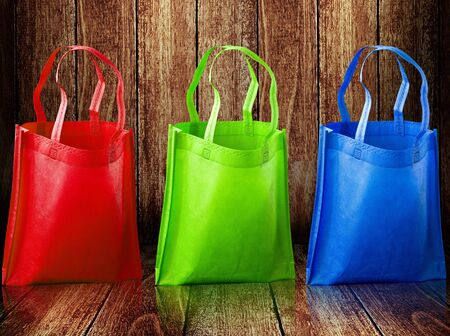 soft sell: Shopping bag on wooden background Stock Photo